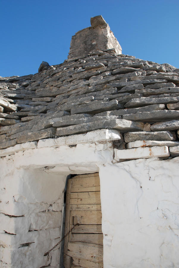 Trullo Door. The door of a trullo in Alberobello in Puglia, southern Italy. The trulli, which are protected under UNESCO World Heritage laws, are traditional stock image