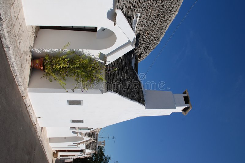 Trullo in Italy. A traditional trullo house in Alberobello in Puglia, southern Italy. The trulli, which are protected under UNESCO World Heritage laws, are stock photos