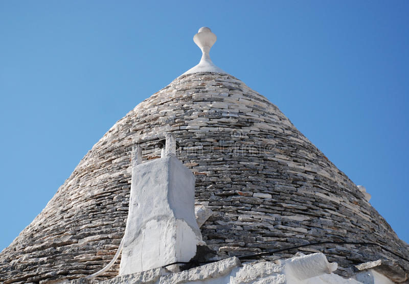 Trullo Roof with Chimney, Alberobello. The roof of a trullo in Alberobello, Puglia, southern Italy. The trulli, which are protected under UNESCO World Heritage stock photo