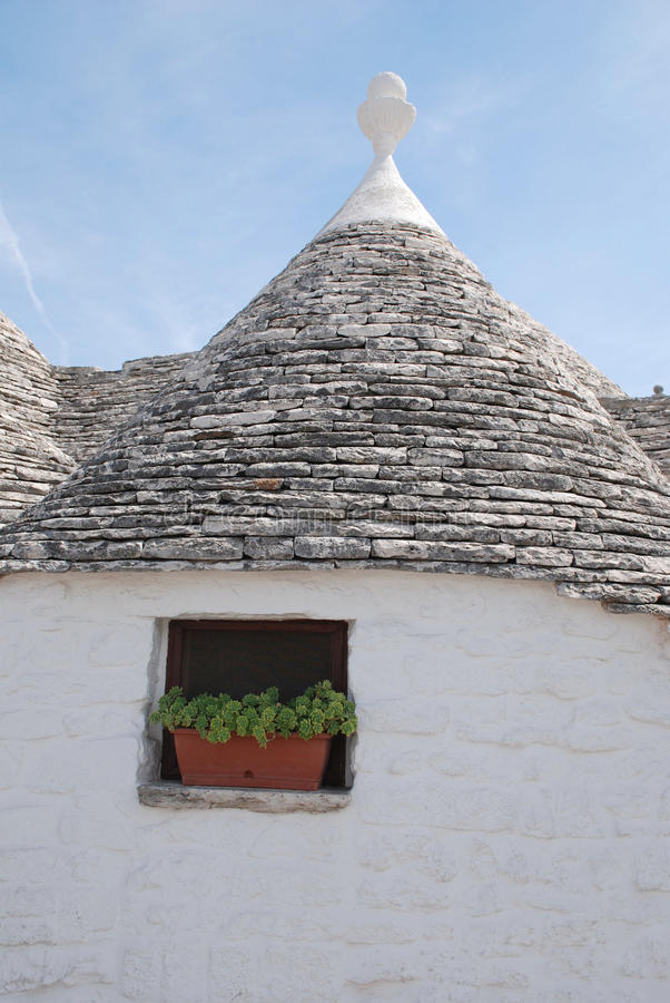 Trullo Roof with Window and Plant royalty free stock photos