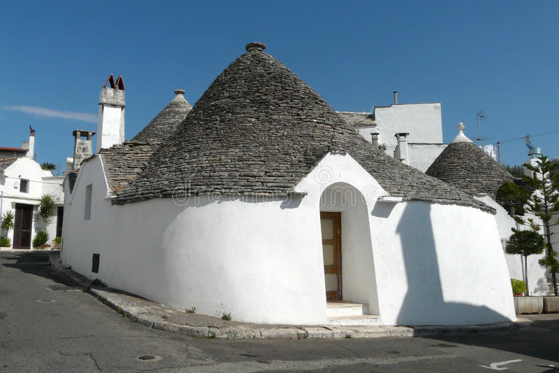 Trullo on the sun of Alberobello. Trullo, the traditional house of the farmers of Alberobello, southern Italy royalty free stock photography
