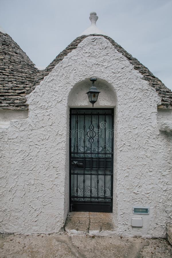 Door nd windows in Trullo trulli city streets in Italy. Trullo trulli ancient unesco Italy cityscapes summer time europe stock image