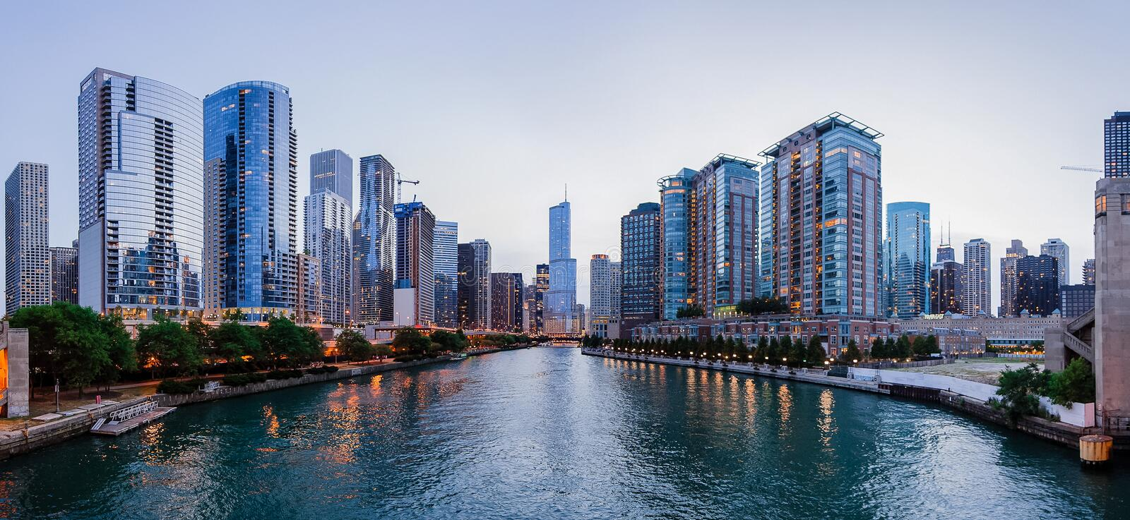 Trump International Tower and other buildings in Chicago. CHICAGO, IL - JULY 7: Trump International Tower and other buildings in Chicago, IL, shown in this river stock photo