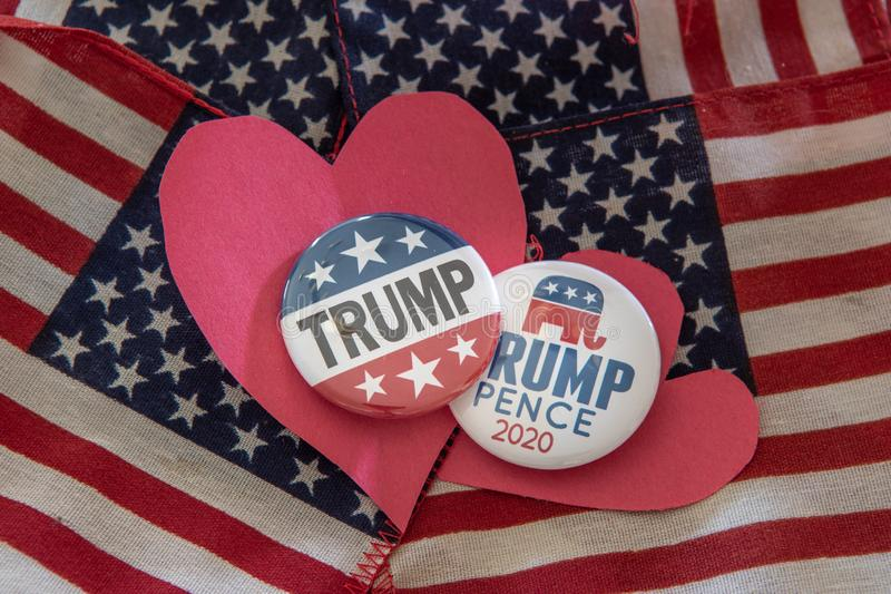 Trump 2020 presidential campaign badges against United Stated flag stock illustration