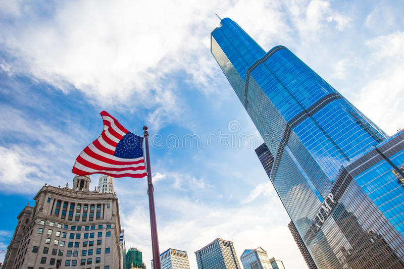 Trump Tower in Chicago. Trump Tower in downtown Chicago with the USA flag flying nearbny on a hot summer's day stock photo