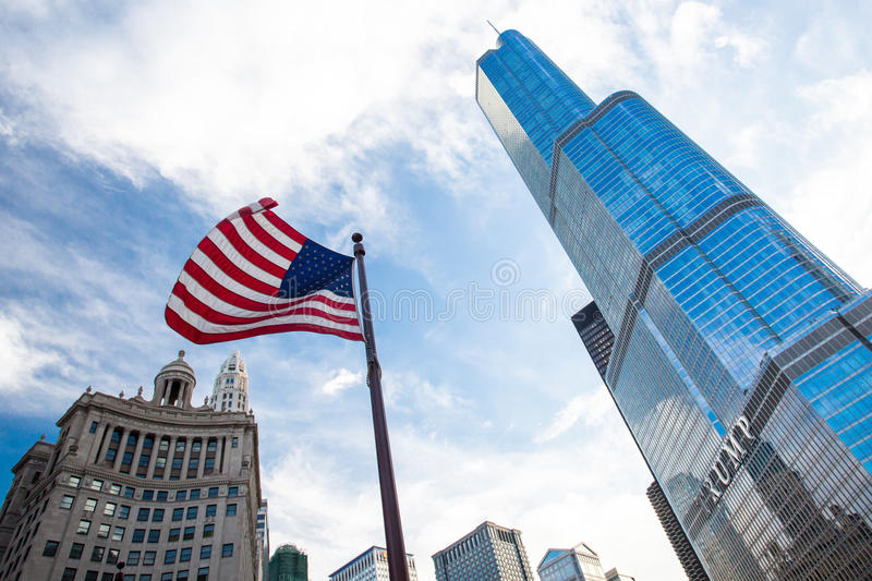 Trump Tower in Chicago. Trump Tower in downtown Chicago with the USA flag flying nearbny on a hot summer's day royalty free stock photography