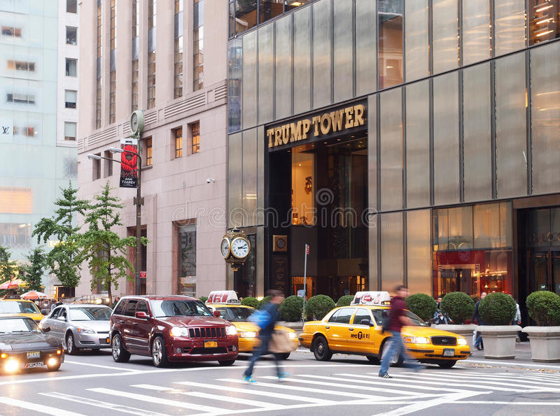 Trump Tower, Fifth Avenue, New York. The Famous Trump Tower on Fifth Avenue in New York City with Iconic yellow cabs and pedestrians walking across the busy stock photo