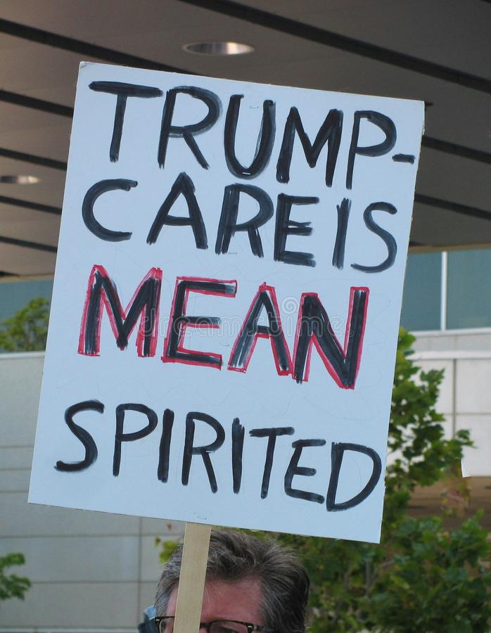 Trumpcare is mean spirited sign at Los Angeles area healthcare rally stock photography