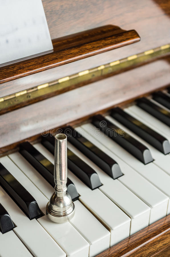 Free Trumpet Mouthpiece Upon The Piano Keys, Close Up Stock Image - 72451621