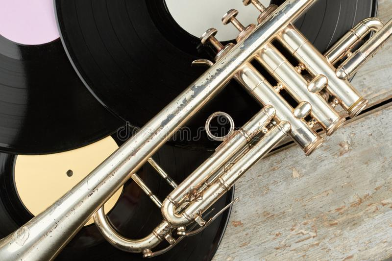 Trumpet and vinyl records close up. stock photos