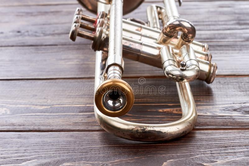 Trumpet on wooden background. stock photo