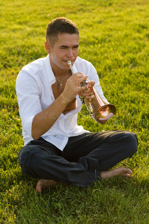 Download The trumpeter on a grass stock image. Image of impact - 7242779