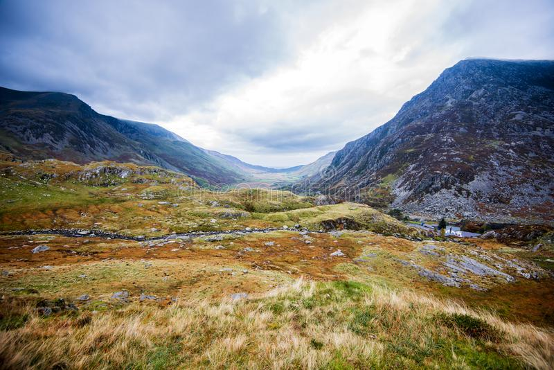 A view down the Nant Ffrancon Valley towards the isle of Anglesey and the sea. stock photography
