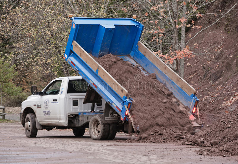 Truro Parks & Recreation Truck. TRURO, CANADA - OCT 28, 2014: Truck unloading fill in Victoria Park. The Parks, Recreation and Culture Department maintains stock photos