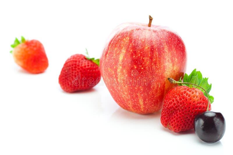 Truskawki i jabłko zdjęcie stock