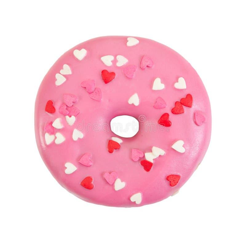 Truskawkowy pączek z różowym mrożeniem i dekoracyjnymi sercami zdjęcie royalty free