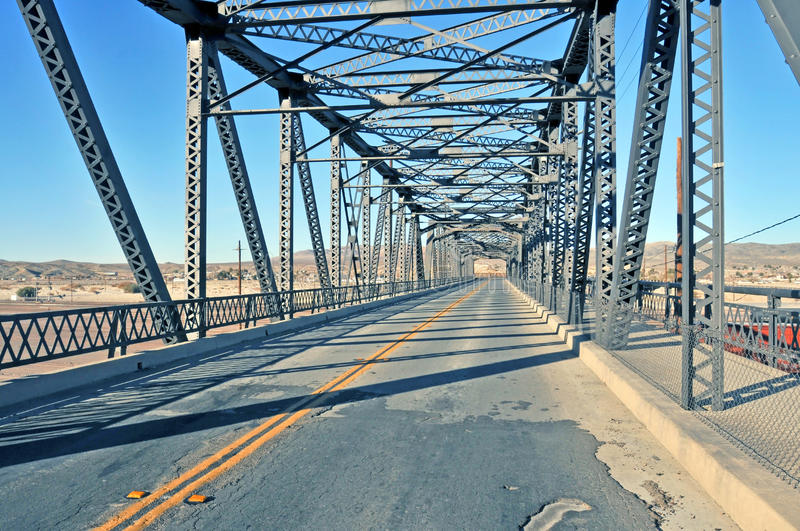 Truss Bridge. Looking like a giant Erector Set, this truss bridge is built using steel girders and cross pieces. It spans the rail yard at Barstow, California stock photography