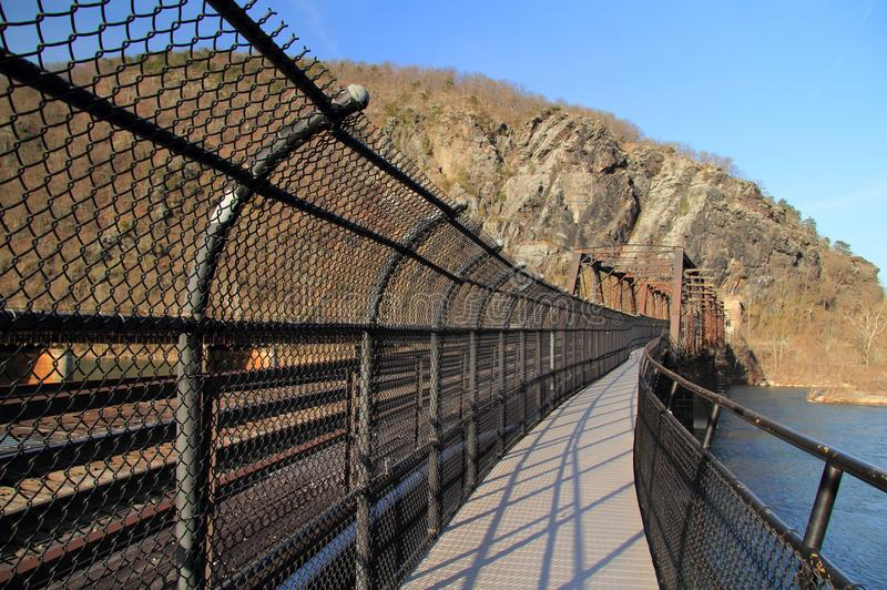 Truss Bridge over the Potomac River. A truss bridge crosses the Potomac River and connects the historic town of Harpers Ferry, West Virginia, to Maryland Heights stock photography