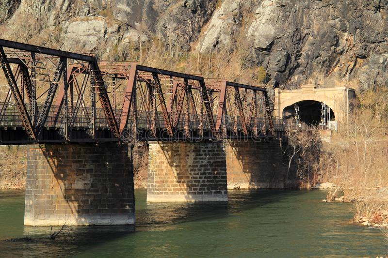 Truss Bridge over the Potomac River. A truss bridge crosses the Potomac River and connects the historic town of Harpers Ferry, West Virginia, to Maryland Heights stock photos