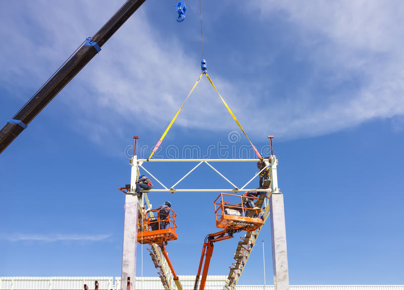 Truss. Erection roof truss work with blue sky background royalty free stock photos