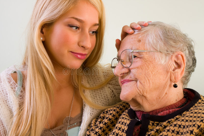 Trust. A young woman stroking an older one whit love and empathy - part of a series stock photo