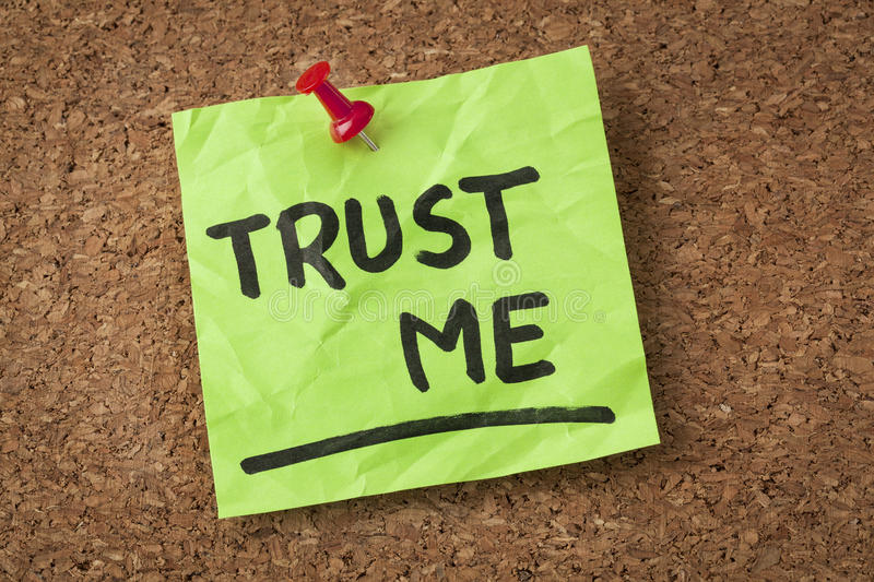 Trust me. Message or reminder - handwriting on green sticky note stock image
