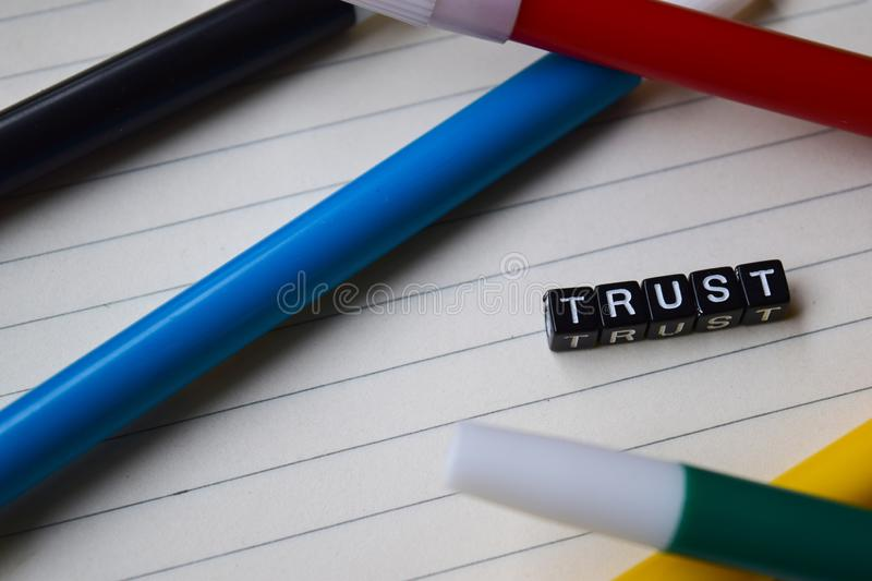 Trust message written on wooden blocks. education and motivation concepts. stock image