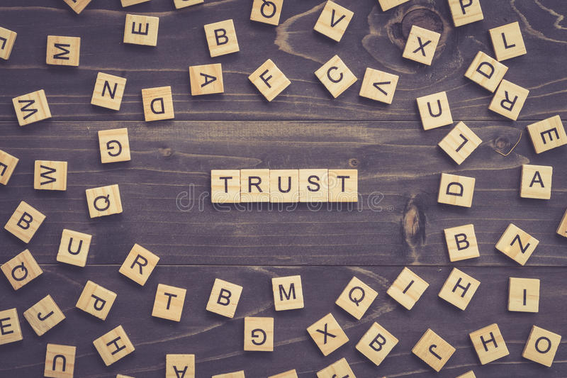 TRUST word wood block on table for business concept. TRUST word wood block on table for business concept royalty free stock photos