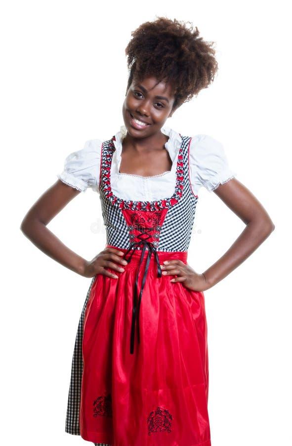 Trwanie amerykanin afrykańskiego pochodzenia kobieta z bavarian oktoberfest suknią obrazy royalty free