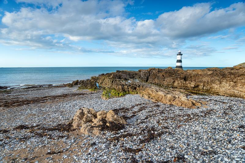 Trwyn Du Lighthouse in Wales. Trwyn Du lighthouse on Penmon Point on the Isle of Anglsey in Wales royalty free stock photos
