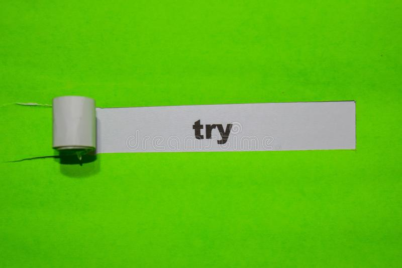 TRY, Inspiration and business concept on green torn paper stock photo