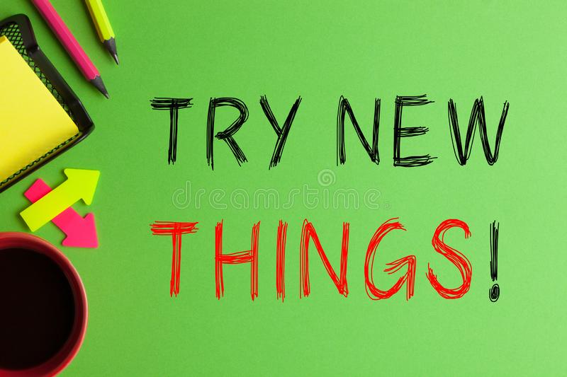 Try New Things. Text messages, cup of coffee and office supplies on green background stock photos