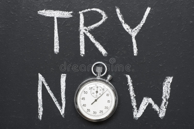Try now. Concept handwritten on chalkboard with vintage precise stopwatch used instead of O stock photography