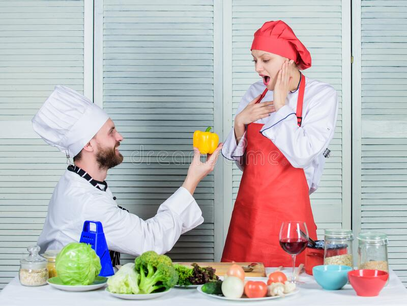 Try this one. vegetarian. cook uniform. Dieting and vitamin. culinary cuisine. Family cooking in kitchen. happy couple royalty free stock photography