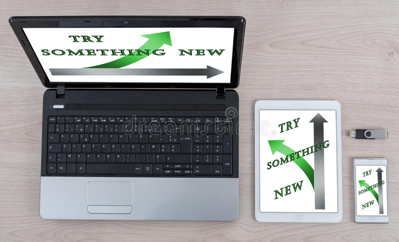 Try something new concept on different devices royalty free stock image