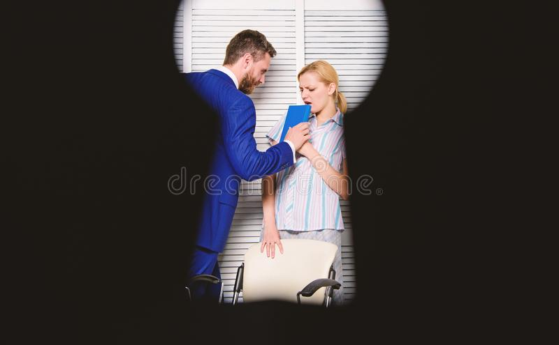 Try to seduce director. Businessman Sexually Harassing Female Colleague. Female with disgusting face. Try to seduce director. Businessman Sexually Harassing royalty free stock photography