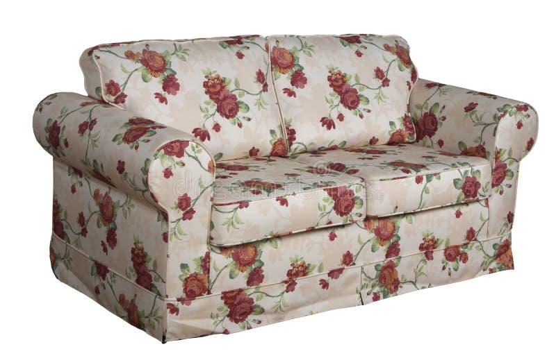 Trycket blommar en soffa arkivfoton