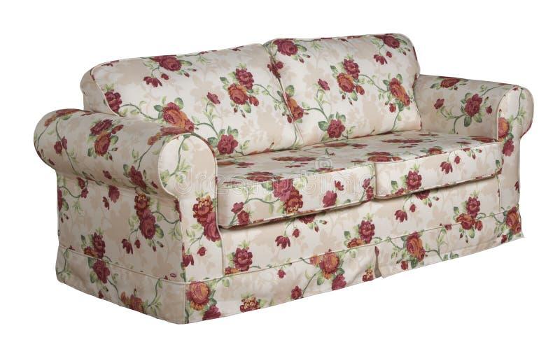 Trycket blommar en soffa royaltyfri bild