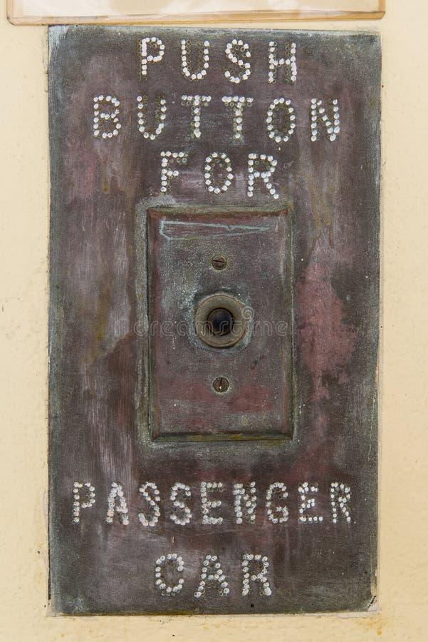 Tryckknapp för passagerarebil arkivbilder