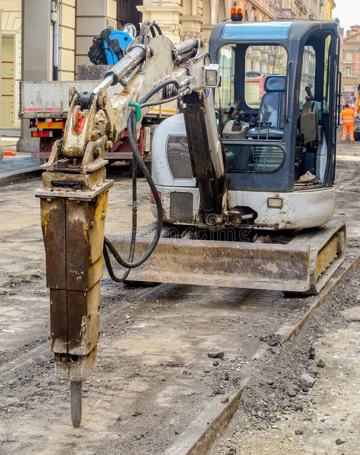 Tryckluftsborrmedelväg som resurfacing att ytbehandla för vägarbete arkivbilder