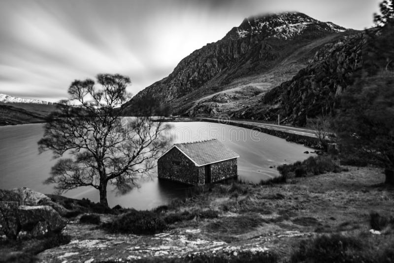 Tryfan Mountain. This being an iconic classic shot of Llyn Ogwen and Boathouse with a backdrop of Tryfan Mountain. Snowdonia National Park, North Wales, United stock photos