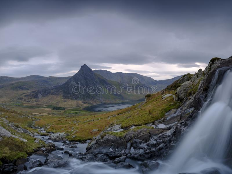 Tryfan in spring with the Afon Lloer in flow over the waterfalls, Wales stock images
