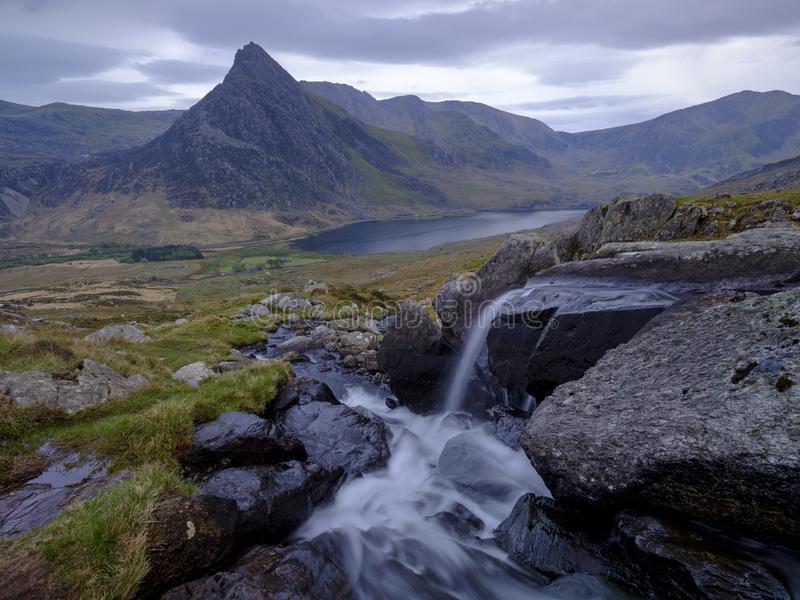 Tryfan in spring with the Afon Lloer in flow over the waterfalls, Wales stock image