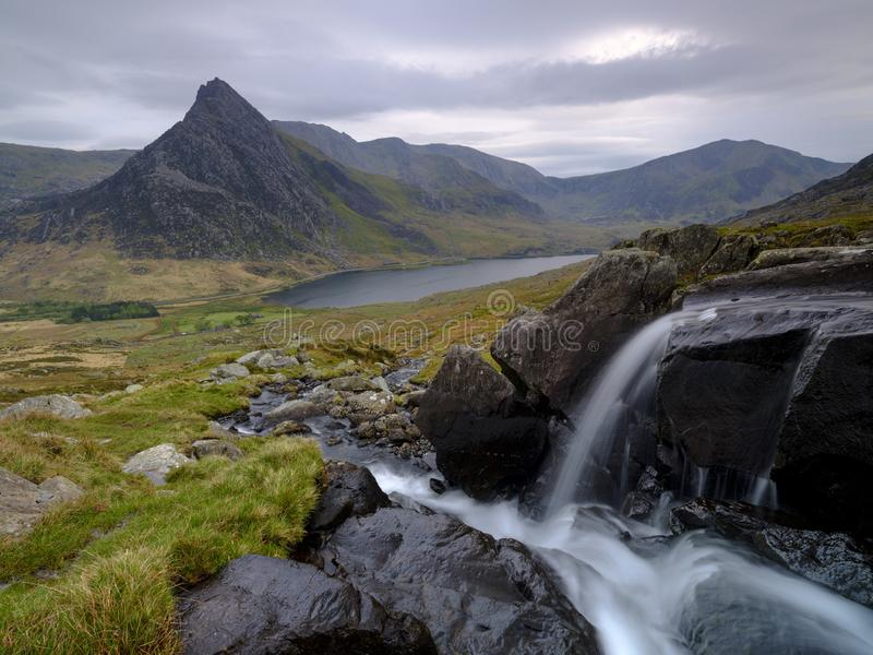 Tryfan in spring with the Afon Lloer in flow over the waterfalls, Wales royalty free stock photo