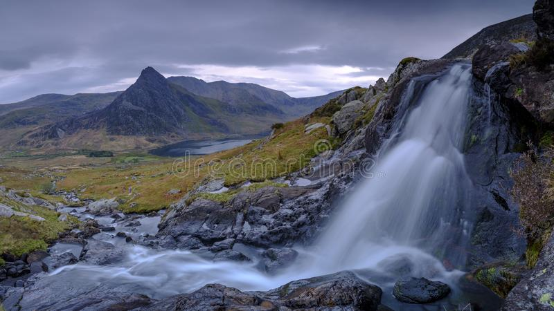 Tryfan in spring with the Afon Lloer in flow over the waterfalls, Wales royalty free stock images