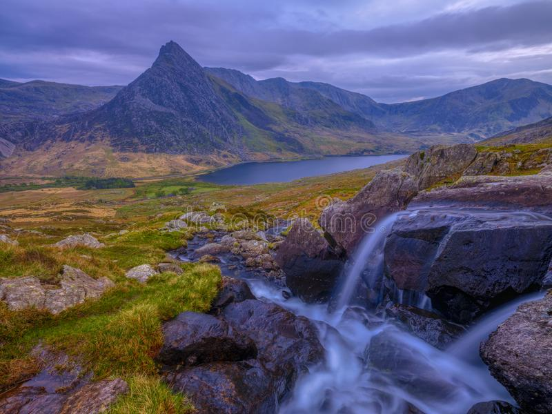 Tryfan in spring with the Afon Lloer in flow over the waterfalls, Wales stock photos