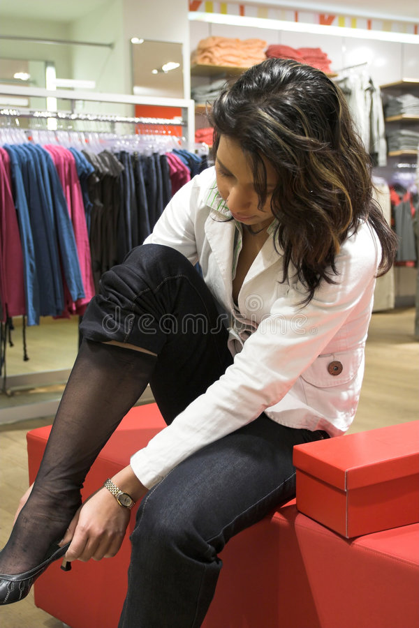 Download Trying On The Latest Shoes Stock Photos - Image: 590263