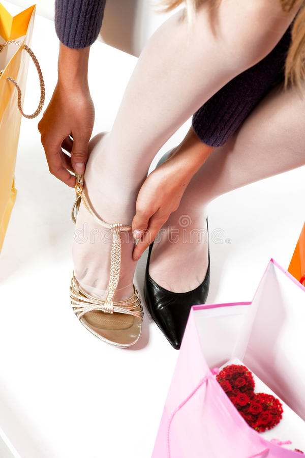 Download Trying on shoes stock image. Image of foot, vertical - 12341357