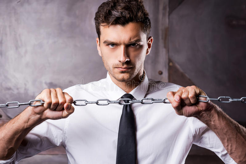 Trying to break a chain. royalty free stock images