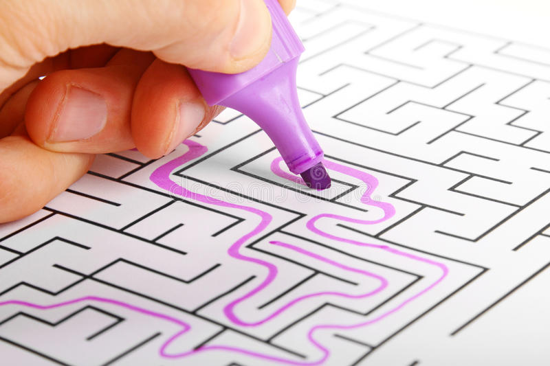 Trying to find way out of maze stock image